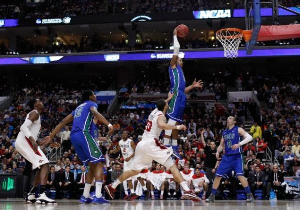 Florida Gulf Coast's Sherwood Brown #25 takes flight in front of San Diego State's JJ O'Brien #20 on March 24, 2013. (Photo by: Rob Carr/Getty Images)