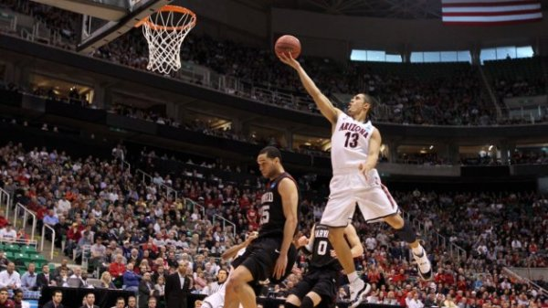 Arizona's Nick Johnson #13 goes for a layup over Harvard's Christian Webster #15 on March 23, 2013. (Photo by: Streeter Lecka/Getty Images)