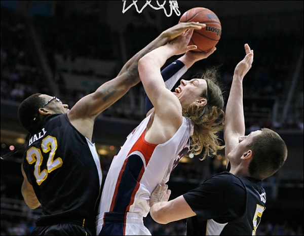 Gonzaga's Kelly Olynyk #13 attempts a shot with heavy resistance by Wichita State's Carl Hall #22 and Demetric Williams #5 on Saturday, March 23, 2013. (Photo by: George Frey/AP)