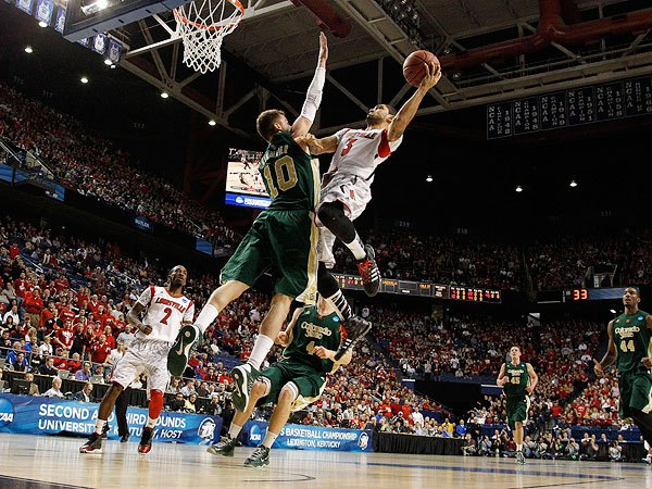 Louisville's Peyton Siva #3 tries to score against Colorado State's Wes Eikmeier #10 on March 23, 2012. (Photo by:John Bazemore/AP)