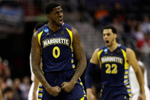 Jamil Wilson #0 and the Marquette Golden Eagles beat the Miami Hurricanes 71-61 on March 28, 2013. (Photo by: Rob Carr/Getty Images)