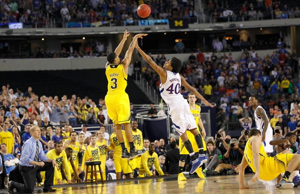 Michigan's Trey Burke #3 shoots a 3-pointer  over Kansas's Kevin Young #40 that sends the game into overtime on March 29, 2013. (Photo by: Mike Stone/Reuters)