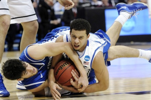Dukes Seth Curry #30 fights for a loose ball against Creighton's Avery DIngman #22 on March 24, 2013. (Photo by: Michael Perez/AP)