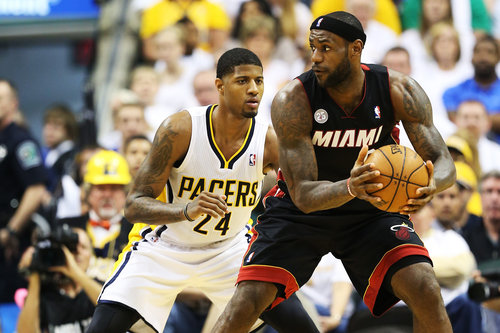 Indiana Pacer forward Paul George has been battling Miami forward LeBron James both literally and on the stat sheet. (Photo by: Andy Lyons/Getty Images)