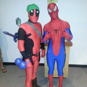 Deadpool dressed as Link and Spiderman.